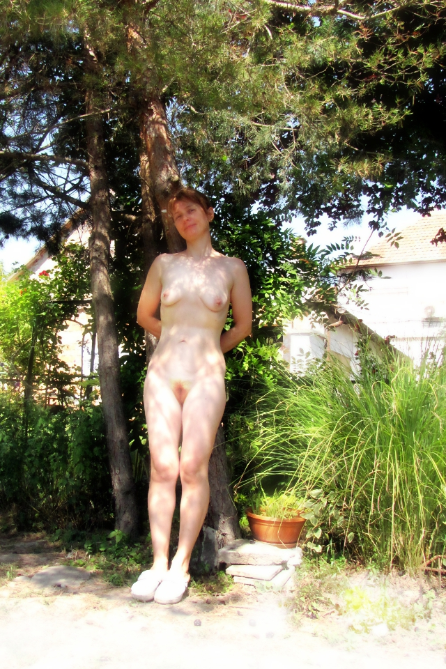 nude-bunny-shy-under-pines-shadow