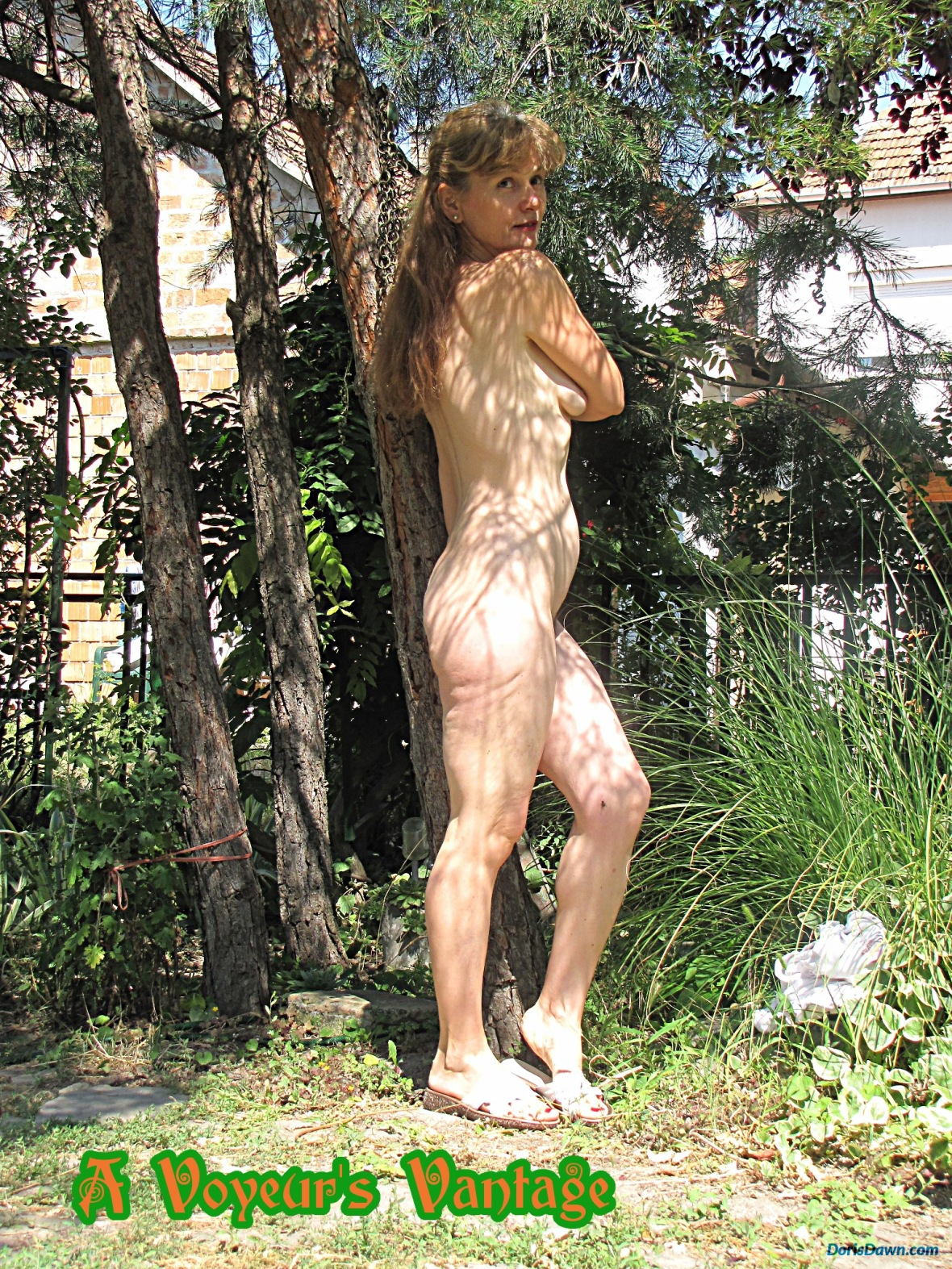 Doris nude in her garden, hiding under the shadow of a cute pine.