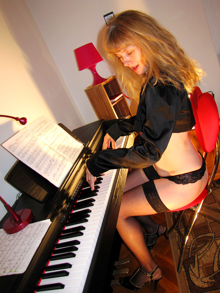 Romantic Doris plays the piano.