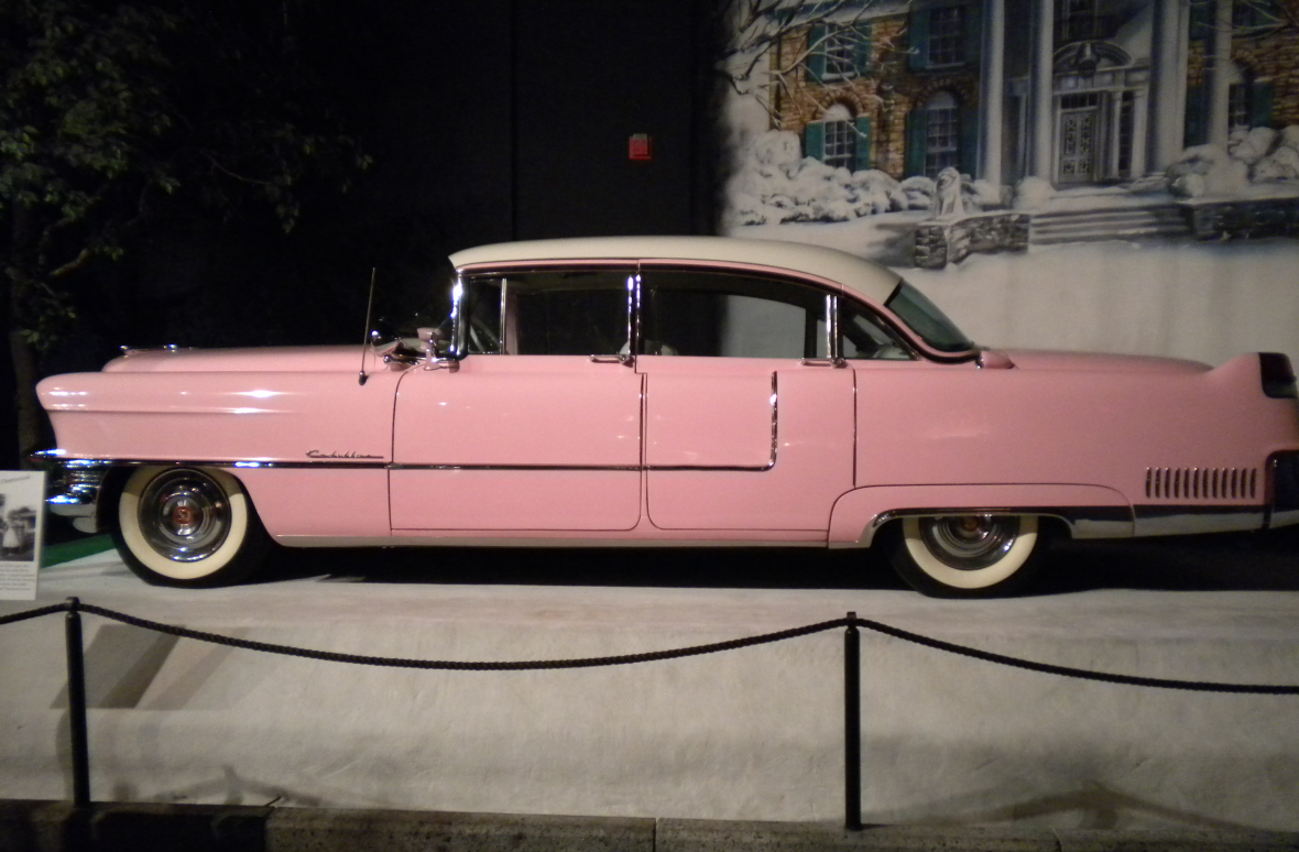 Corkythehornetfan - https://commons.wikimedia.org/wiki/File:Elvis_Presley_Pink_Cadillac_on_display.png